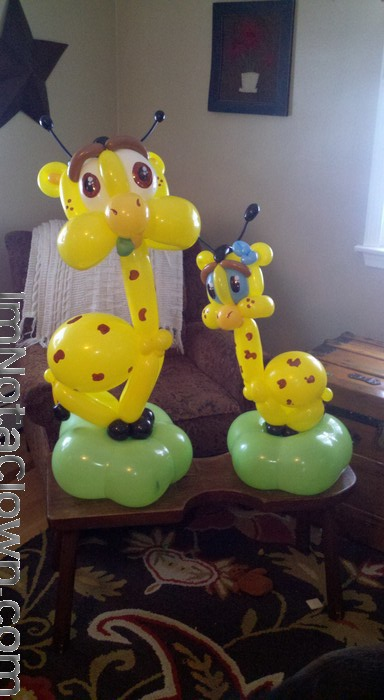 A baby shower balloon. Cute Giraffes eating leaves.